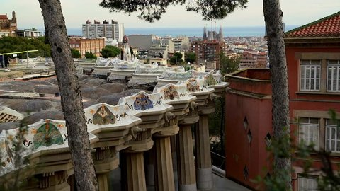 The Gaudi benches at Park Guell overlook the Sagrada Familia in Barcelona, Spain.