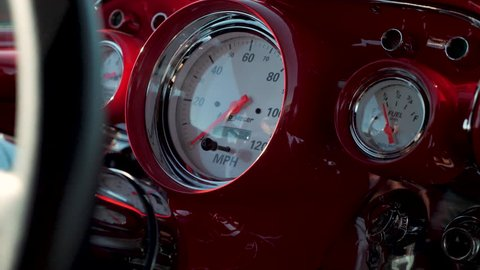 Close Up Red Dashboard of 1950's Classic Muscle Car