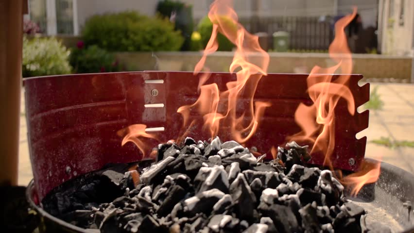 Charcoal barbecue on fire burning grill barbecue  | Shutterstock HD Video #1014385976