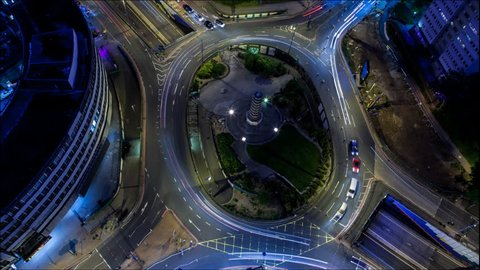 Birmingham, England. Time Lapse of a traffic roundabout at night. Camera zooms in.