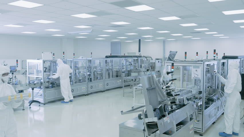 Sterile High Precision Manufacturing Laboratory where Scientists in Protective Coverall's Turn on Machninery, Use Computers and Microscopes, doing Pharmaceutics, Biotechnology and Semiconductor Resear
