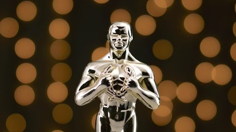 MONTREAL, CANADA - August 2018 : Golden oscar statue on display with the camera turning around the prestigious figure.