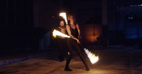 Male and Female Fire Spinners Performing Fire Poi In Darkness Playing With Fire Professional Stunt Low Light Fog Slow Motion 8k Red Epic
