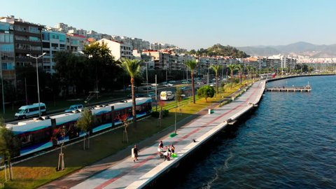 Tram of Izmir riding along the sea side of the city.