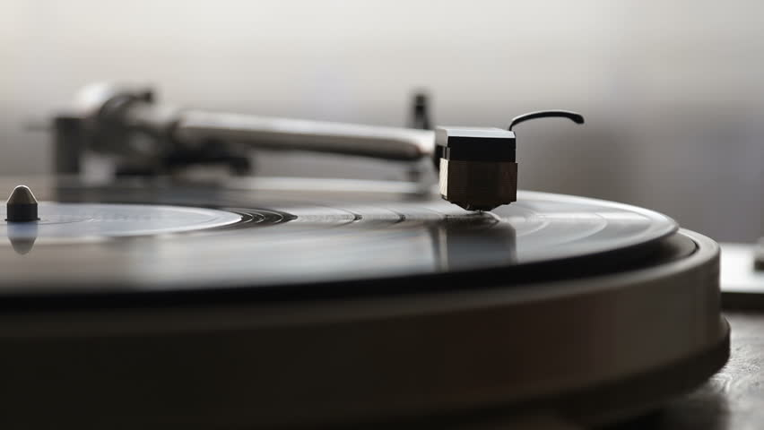 Turntable player, dropping stylus needle on vinyl record playing | Shutterstock HD Video #1014498146
