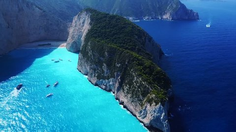 Aerial top view video from iconic Navagio or Shipwreck beach one of the most beautiful in the world with deep turquoise clear sea, as seen from above , Zakynthos island, Ionian, Greece