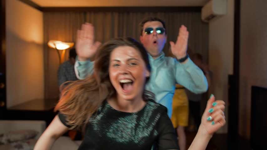 Young married couple funny dancing at evening party, slow-motion Ultra HD shot. They happy of weekend start. Today is friday ending! | Shutterstock HD Video #1014515996