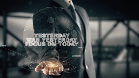 Yesterday was yesterday focus on today with hologram businessman concept
