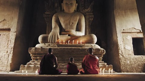 Authentic real monks In Bagan Mayanmar / Burma doing meditation in ancient temple.