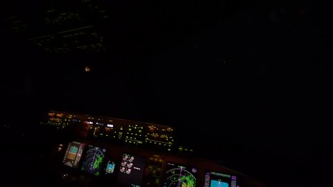"""Lightning strike on airplane cockpit window at high altitude. Some call """"Saint elmo's fire or Saint elmo's light"""" is a weather phenomenon in which luminous plasma is created by a coronal discharge."""