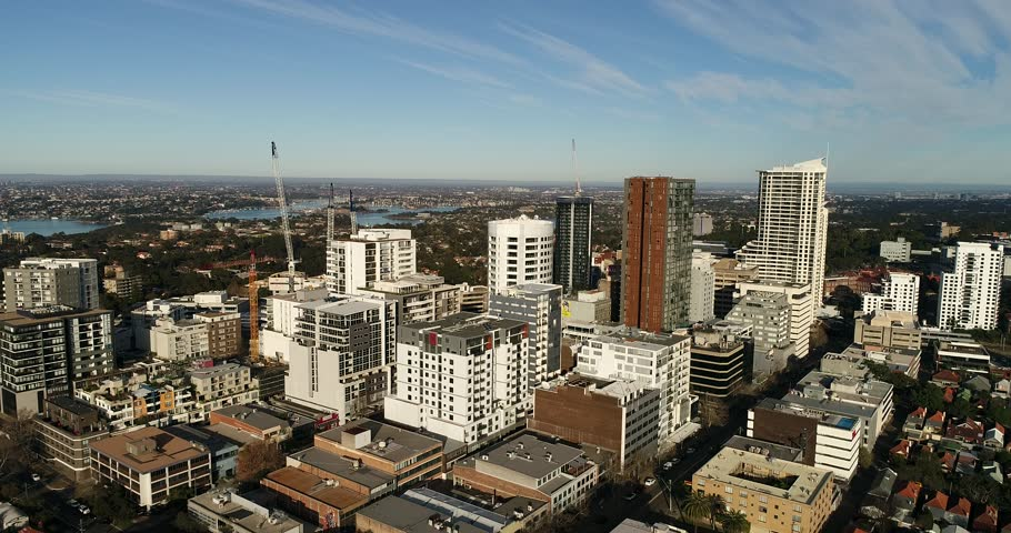 Rotation in North Shore residential suburb St Leonards from tall high-rise apartment towers to North Sydney CBD area.