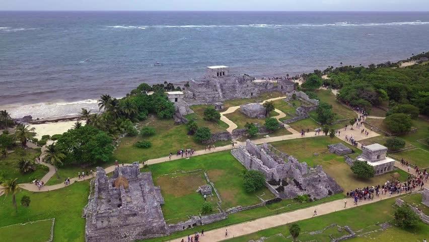 Aerial Drone Top View Mayan Temples on Beach Sand Water Ocean Green Lush Jungle Rocks Palm Trees Caribbean Coastline Sea Shore Summer Tulum Mexico Ancient Ruins 4k footage Mayan Riviera Quintana Roo