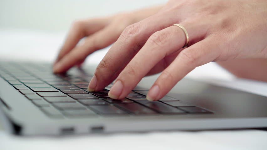 Close up young business woman typing on laptop keyboard on white bed cover. Female freelance blogger hands busy typing on computer to writing content or article to web blogs for internet marketing. | Shutterstock HD Video #1014611096