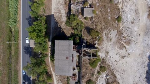 Overhead downward view of a Marble Quarry, abandoned industrial equipment.