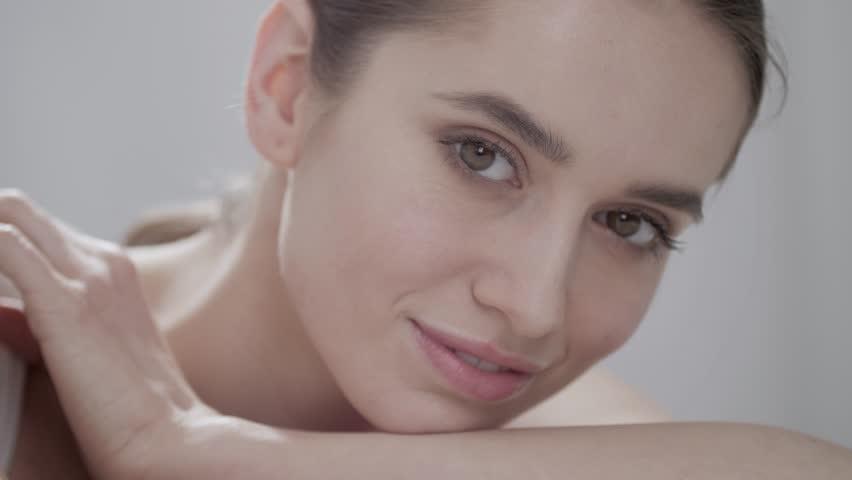 Natural Beauty. Beautiful Woman With Makeup Smiling Closeup | Shutterstock HD Video #1014622436