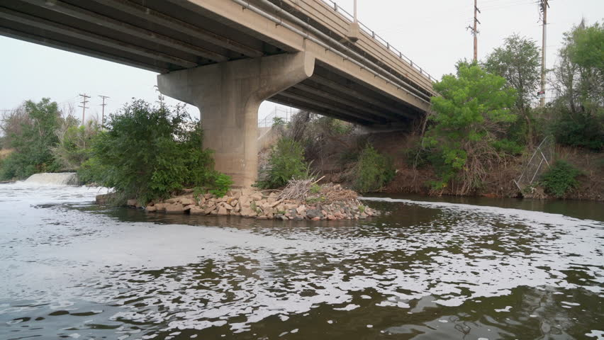 sewage effluent from Denver metro wastewater treatment facility is creating a foam vortex upstream the South Platte River in Colorado