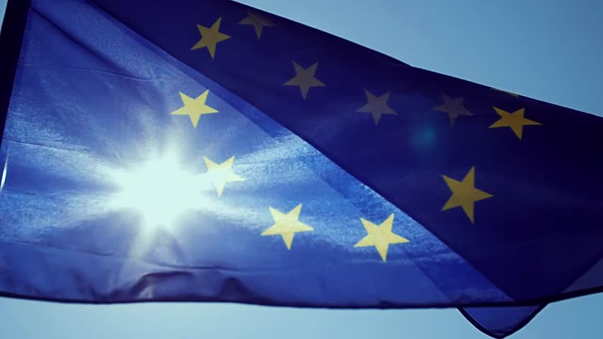 Waving European Union flag in the wind with a blue sky. | Shutterstock HD Video #1014648656