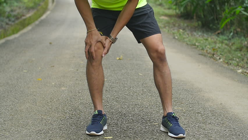 Young Fitness Man Holding His Knee Injury  | Shutterstock HD Video #1014649466