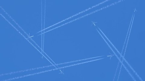 Air traffic. View of airplane jet layer white trace vapour on blue clean sky