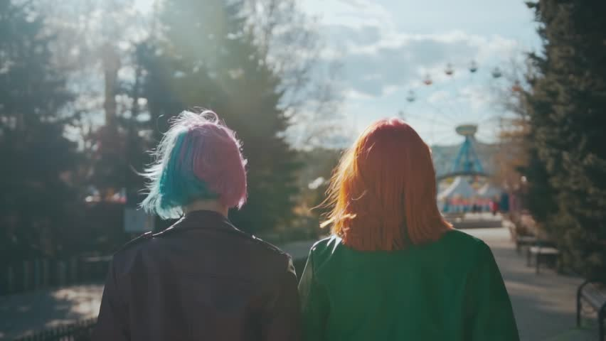 Redhead girl and her girlfriend with blue and pink dyed hair | Shutterstock HD Video #1014669326