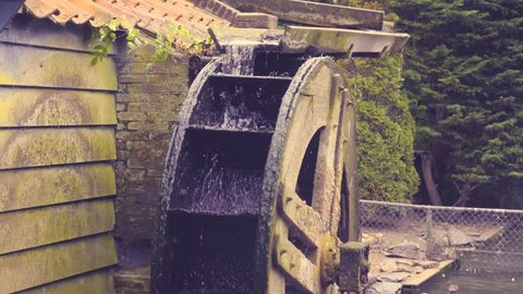 Close up of spinning water wheel in slow motion. Filmed at 240fps.