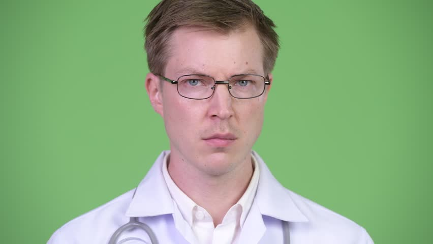 Serious Man Doctor Shaking Head And Saying No   Shutterstock HD Video #1014681176
