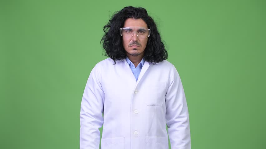 Crazy scientist wearing protective glasses scratching head