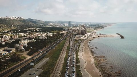 Haifa city split view of the sea and the Meridian hotel in the background