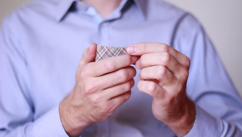 Businessman holding playing cards | Shutterstock HD Video #1014736796