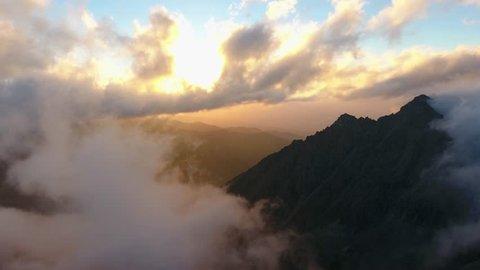 Flight through moving white cloudscape with beautiful sun rays. Almaty, Kazakhstan.