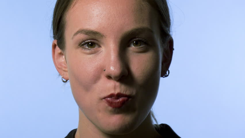 Young Woman Chewing Bubble Gum #1014746486