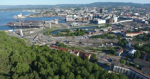 Aerial view at sentrum of Oslo city. Compact, bustling downtown witn new constructions, roads and streets. Camera review. Norway