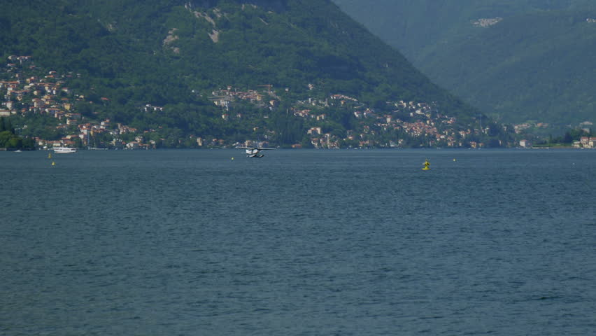 Floatplane landing on Lake Como in Italy