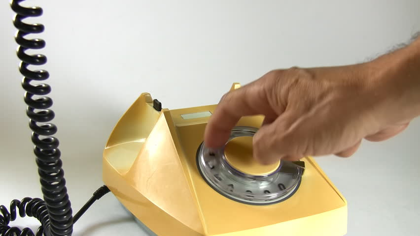 Man lifting old aged landline telephone receiver and dialing number; close up, audio, white with shadows background
