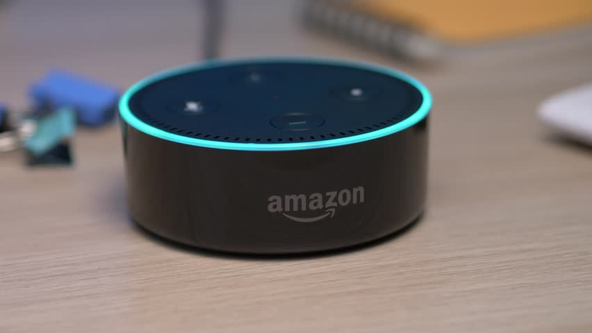 MONTREAL, CANADA - August 2018 : Smart home assistant device being used with voice commande on a desk. Amazon Echo Alexa