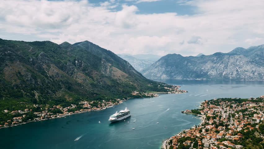 View of kotor old town from Lovcen mountain in Kotor, Montenegro. Cruise ship docked in beautiful summer day. | Shutterstock HD Video #1014902866