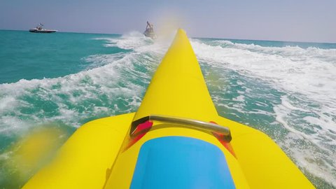 GoPro Footage of a Bananaboat. Riding a yellow Banana Boat in view of the person POV. Go Pro watersport fun on bananaboat.