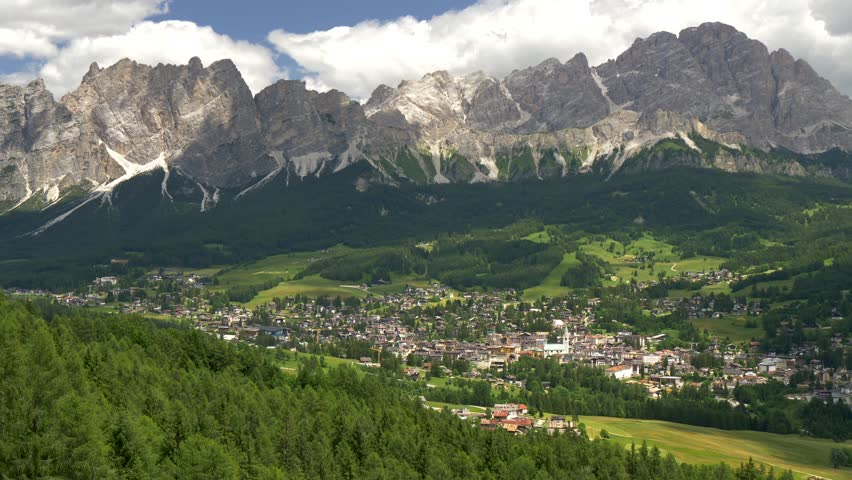 Cortina d'Ampezzo, Italy. Panning shot of alpine green landscape and Dolomites Alps. Province of Belluno, South Tyrol, Italy.