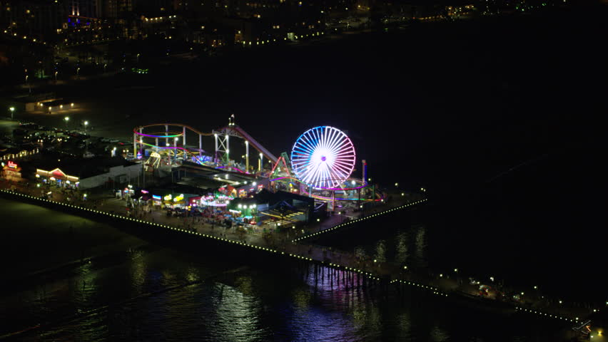 Aerial view of the Santa Monica Pier in Los Angeles, California at night. Shot with a RED camera. 4k footage.