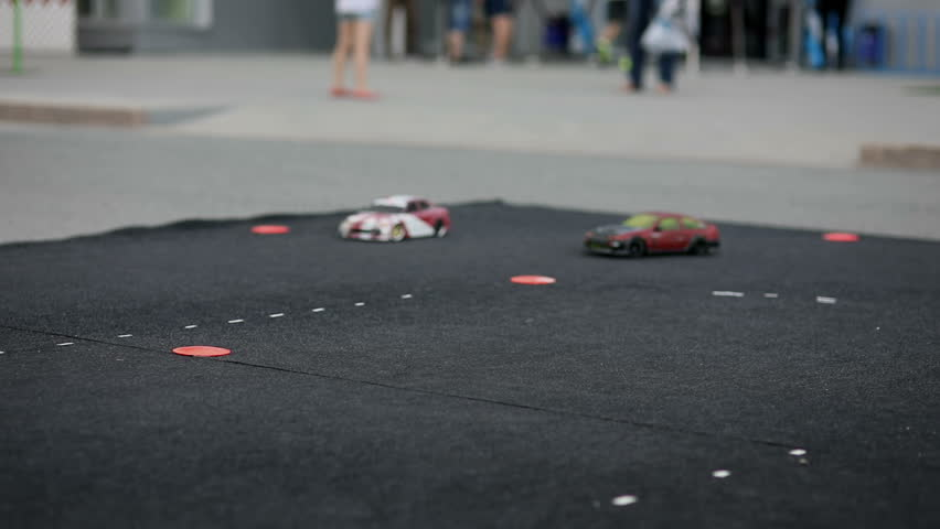 Drift cars perform joint stunts close up