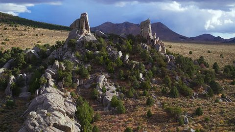 Flying through a pair of rock spires at City of Rocks National Reserve in Idaho
