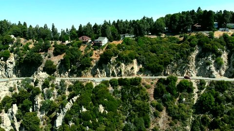 Drone Shot Flying Out from the Side of a Mountain near Lake Arrowhead in San Bernardino, California