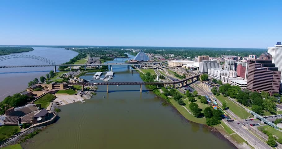 Cityscape aerial skyline shot flying next to the Mississippi River in Memphis Tennessee during the day