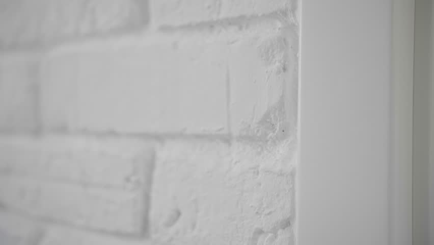 The wall is made of white brick