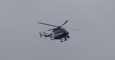 Police helicopter spying. Police service commonly use aircraft for traffic control, air patrol and control of large-scale public events. Germany, Europe.