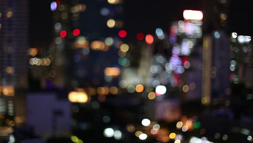 Blurred bokeh of Electric trains in bangkok and Defocused night traffic lights, Expressway and Road traffic Transportation Systems In Thailand