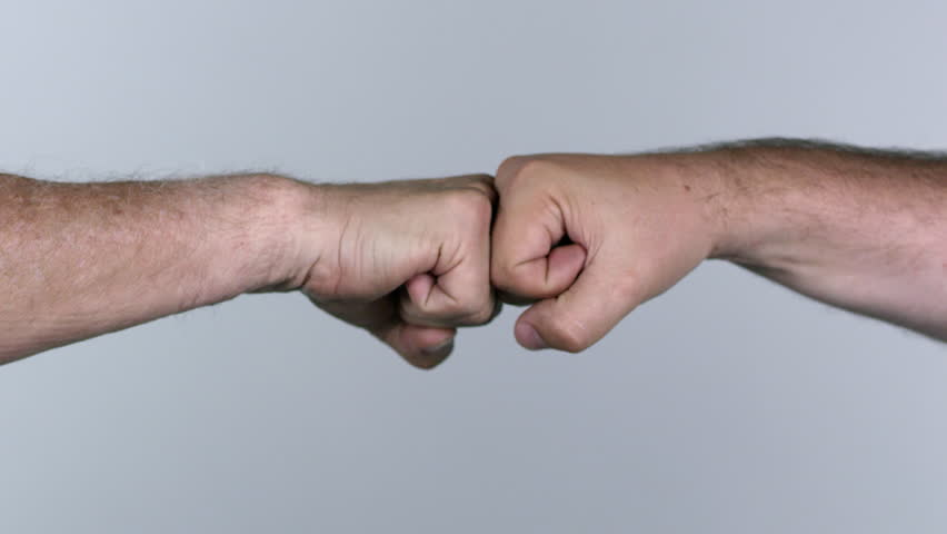 Two men fist bumping against white screen. | Shutterstock HD Video #1015100866