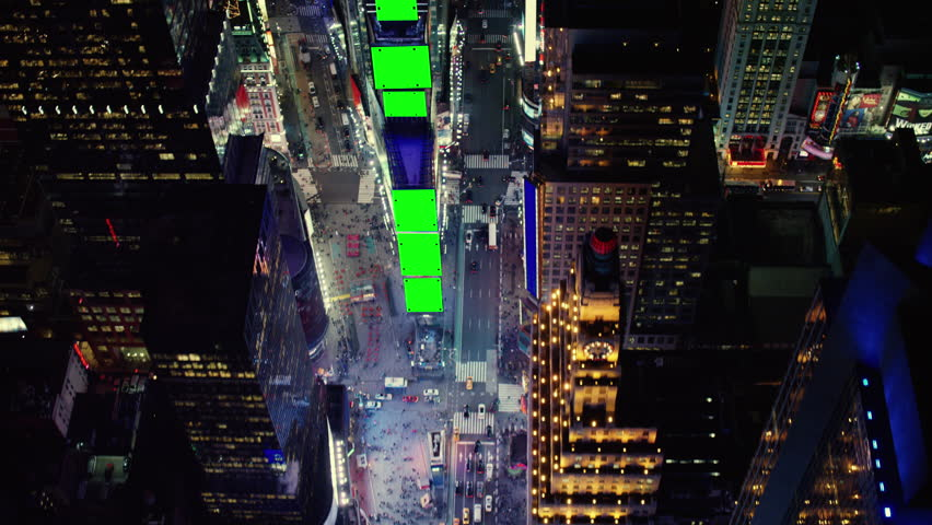 Aerial view of a busy metropolitan city during the night. Shot of Times Square in New York City with Green Screens. Shot with a RED camera. 4k footage.