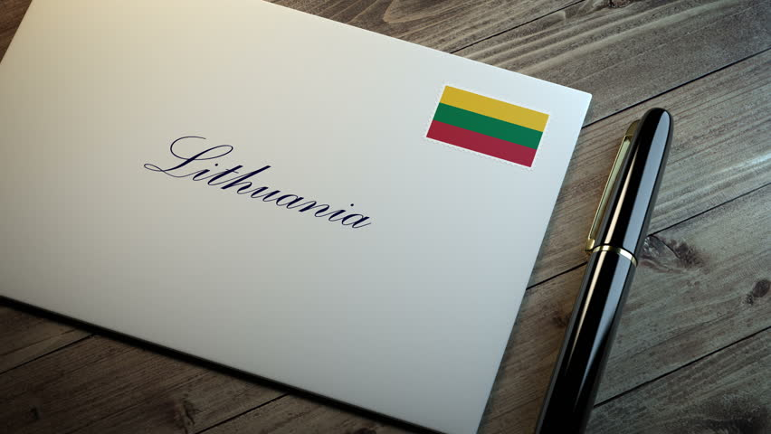 Country name written on a card or envelope in cursive font with a sleek pen on a wooden table surface under beautiful classy light. Stamp in the corner shows the flag of Lithuania | Shutterstock HD Video #1015206346