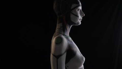 Humanoid android woman turns back, slow motion